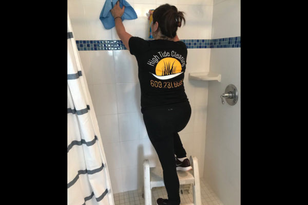 Dee Cleaning a Shower